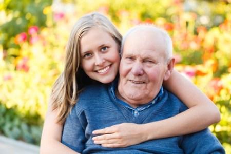Beautiful granddaughter visiting her elderly kind grandfather.