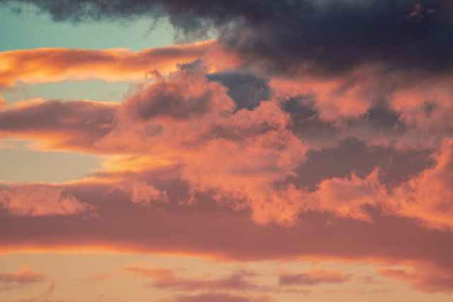 sky with fluffy clouds in sunset
