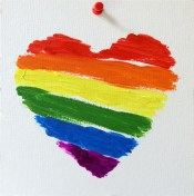 Rainbow flag symbolizing LGBTQ+ community in heart shape
