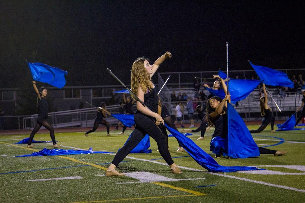 Freshman+colorguard+performer+Emma+Ford+performs+in+the+halftime+show.%0A