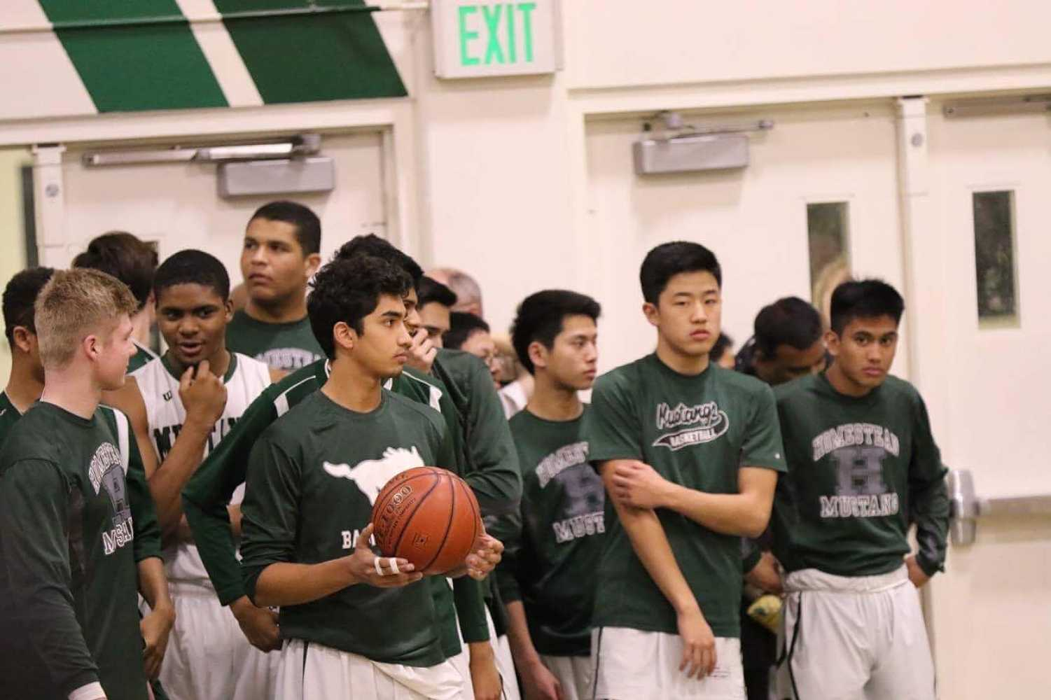 HHS boys varsity team loses CCS game to IHS with a final score of 59-57.