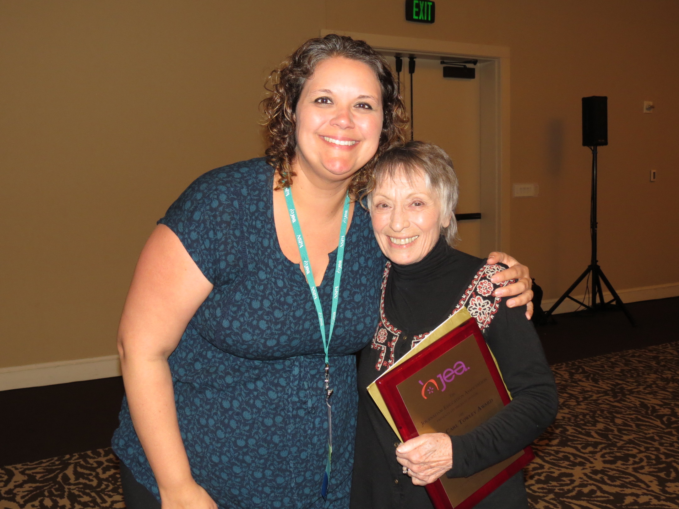 Adviser Natalie Owsley presents the Carl Towley award to Dina Ferentinos. Photo courtesy of Edmond Kwong