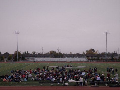 The senior class of 2018 on the football field waiting for the sun to rise.