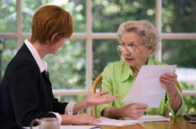 Older woman reviewing documents