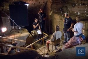 Filming D. Craig Young inside Hidden Cave.