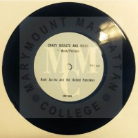 Photograph of the 33 ½ rpm vinyl record by Don Preston and Meredith Monk of Candy Bullets and Moon in 1967 out of the sleeve from the William Harris Papers.