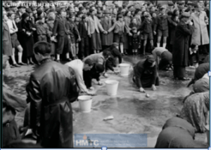 Jewish people scrubbing the sidewalk in Austria (1938).