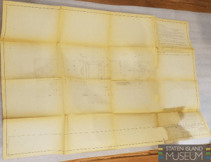 A watermarked photograph of blueprints.