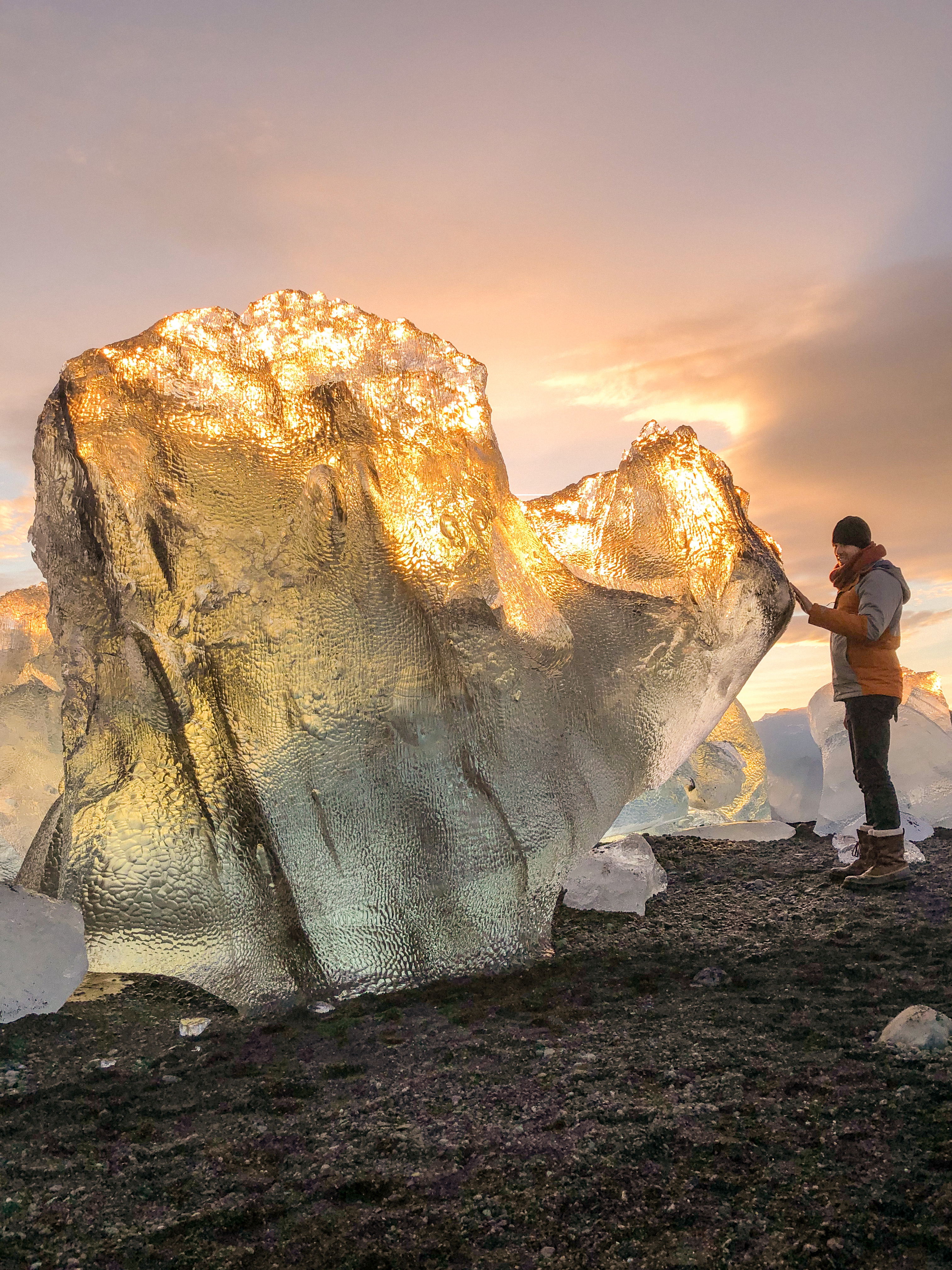Large glacier ice washed up on 'Diamond Beach' by Jökulsárlón glacier lagoon at sunset. Photo by Scott Drummond, Hidden Iceland