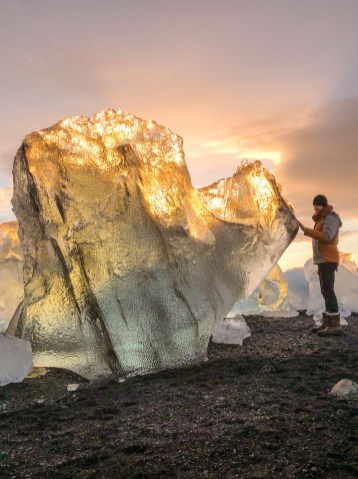 Large glacier ice washed up on 'Diamond Beach' by Jökulsárlón glacier lagoon at sunset. Photo by Scott Drummond, Hidden Iceland