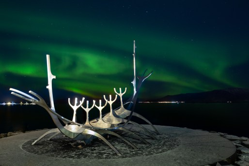 Northern lights over the Sun Voyager sculpture in Reykjavik by Simon Svensson
