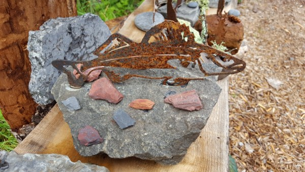 hidden in the rocks art gallery metal and stone items