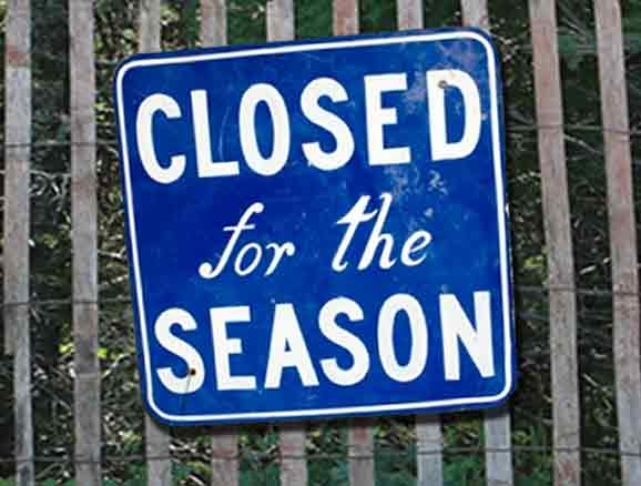Sign reading: Closed for the Season.