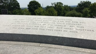 Iconic JFK quote at his gravesite with the Washington Monument in the background.