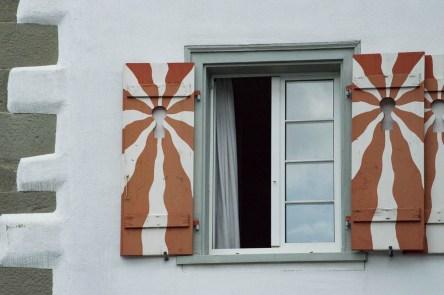 Window shutters with sun pattern