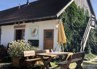 Sitting in front of the farm shop of Bumbaurhof
