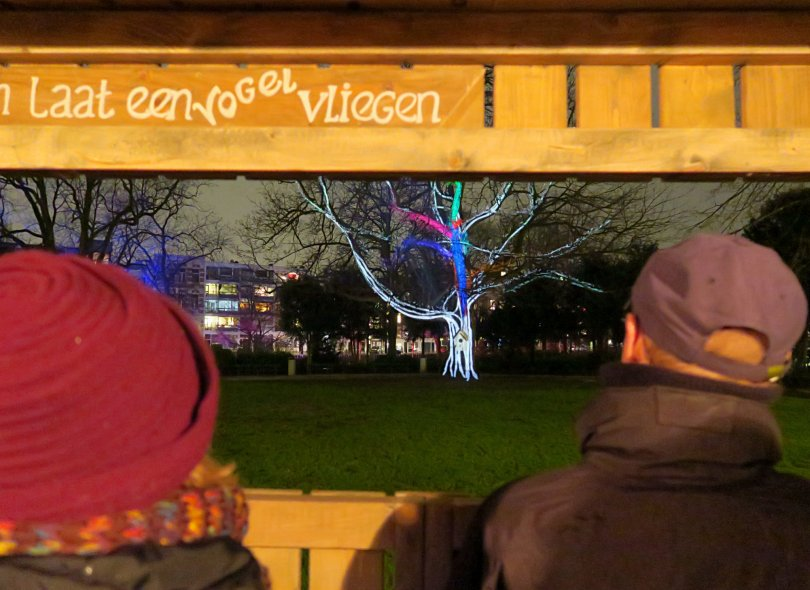 As you enter this huge wooden birdbox, a bird (projected on the tree opposite you) starts to fly. The more people come in the birdbox, the more birds will start to fly.