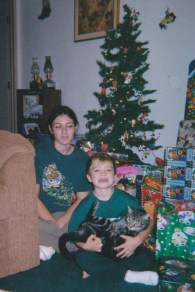 Another Christmas with me and Orin, and our cat Howdy. Note the perennial Dollar General tree behind us.