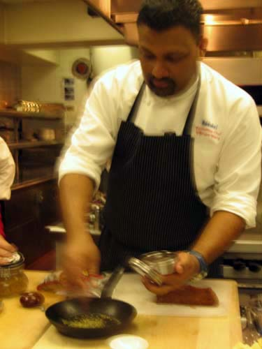 Vikram Garg prepares to toast a spice.