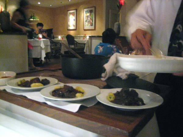 Tableside beouf bourgignon service at Chef Mavro