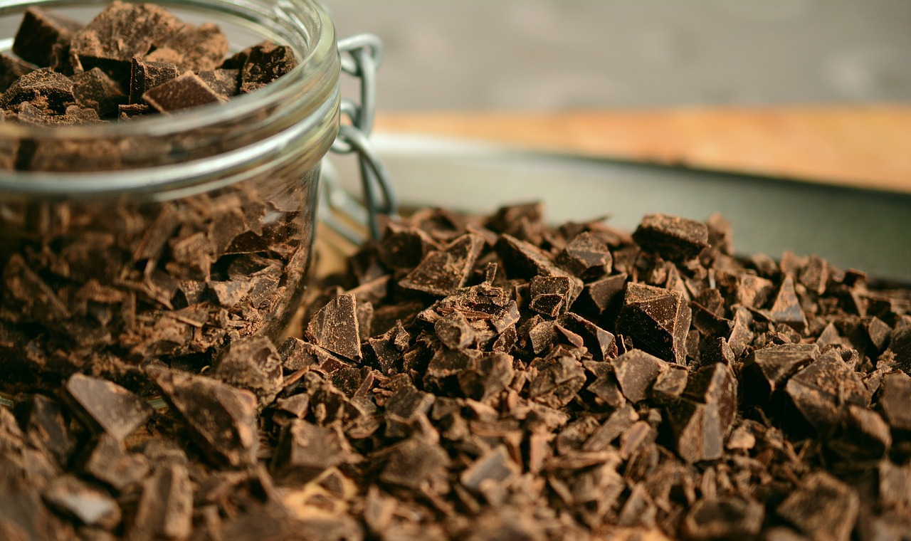 Pieces of chocolate in glass jar