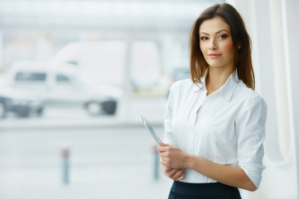 Business Woman Holding a Tablet Computer.