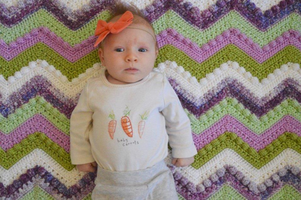 Love my little baby carrot on her Hugs n Kisses Baby Blanket!