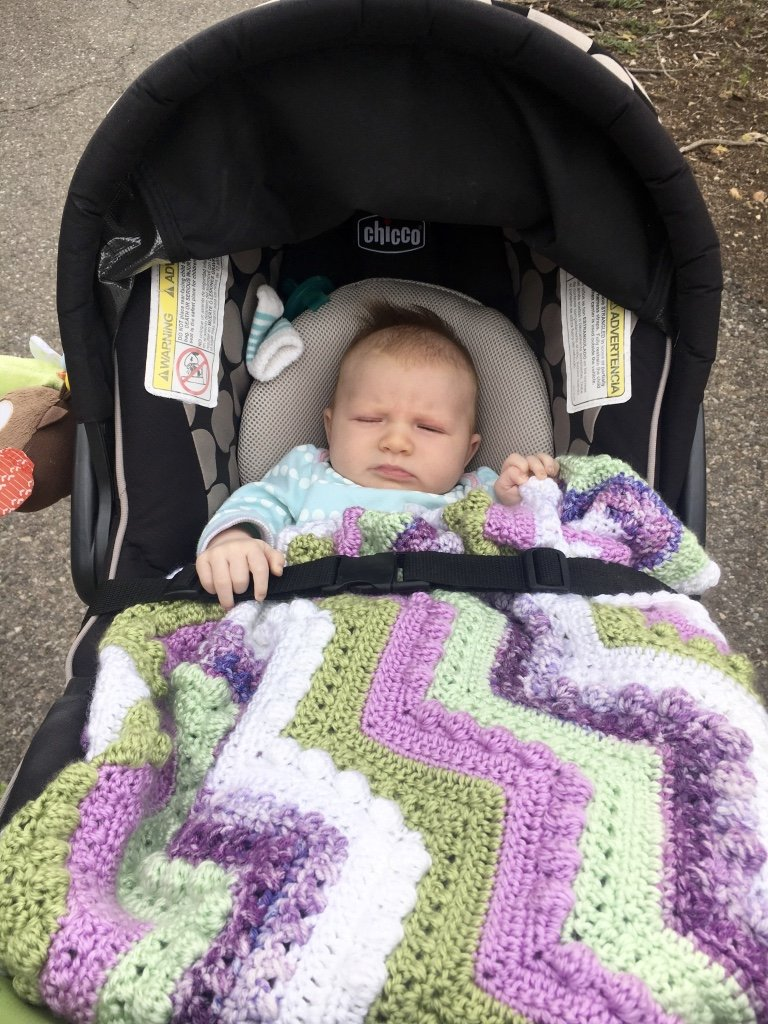 Emma's first stroller walk. She was super enthused, but at least she was cozy in her Hugs n Kisses Baby Blanket!