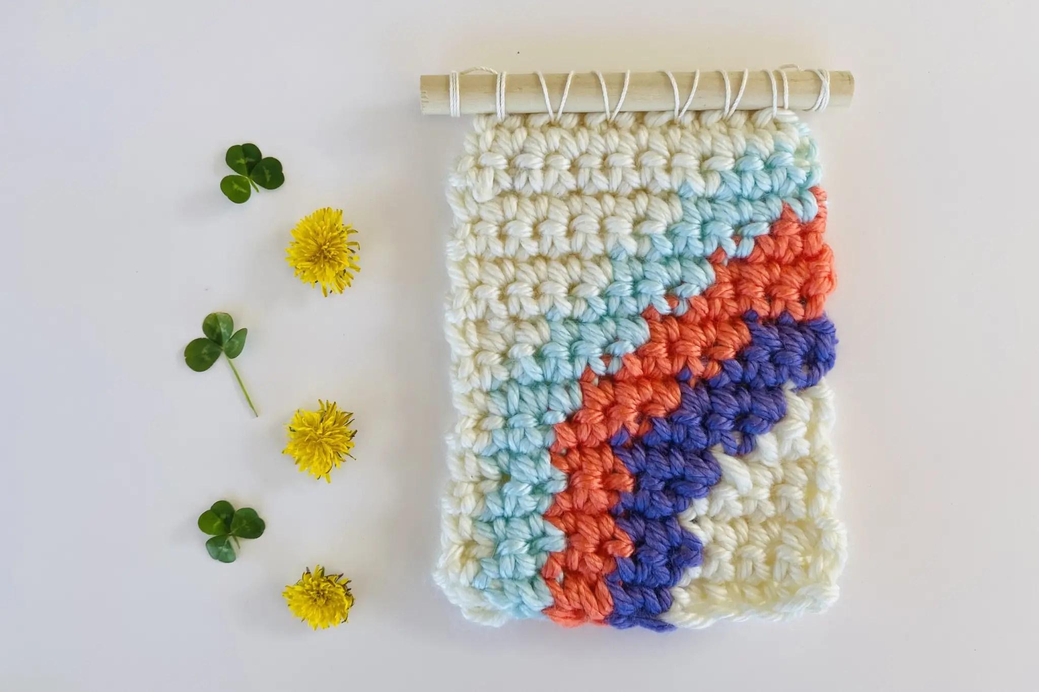mini crochet rainbow wall hanging