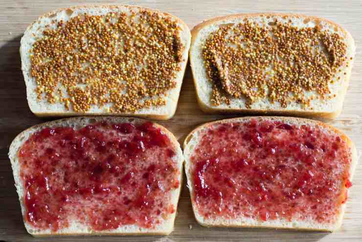 image of mustard and jam spread on bread