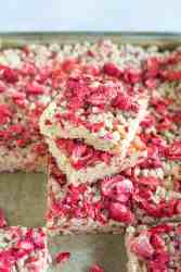 image of vegan strawberry rice crispy treats stacked and vertical