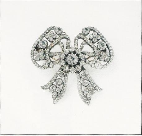Broche noeud, Cartier Paris, 1898, or, argent, diamants taille ancienne et rose.
