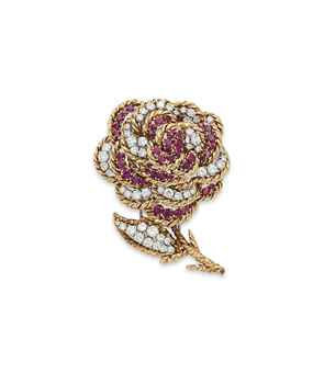 A DIAMOND AND RUBY FLOWER BROOCH, BY VAN CLEEF & ARPELS Designed as a circular-cut diamond and ruby flower, to the circular-cut diamond leaf, with gold wirework detail, mounted in white and yellow gold, with maker's marks.