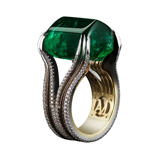 A Sugarloaf-Cabochon Emerald & Diamond Ring A 26.16 carat Sugarloaf-cabochon Emerald ring set with Alexandra Mor's signature details of double bands of 1mm knife-edged wire and 0.84 carats of 1mm 'floating' Diamond melee. 18-karat white gold set on a 1mm 18-karat yellow gold band with AM logo gallery. Created with a Gemfields gem, where all Emeralds are ethically sourced from mine to market. Signed by artist. Crafted in the USA. One-of-a-Kind 1/1