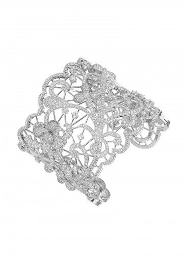 The dazzling beauty of this cuff bracelet in 18-carat white gold, with its fine lacework like details entirely diamond-set, is an exquisite testimony to Chopard's exceptional expertise. Crafted with Fairmined gold and diamonds sourced from a producer who is a certified member of the Responsible Jewellery Council, this Haute Joaillerie creation is part of Chopard's Green Carpet Collection.