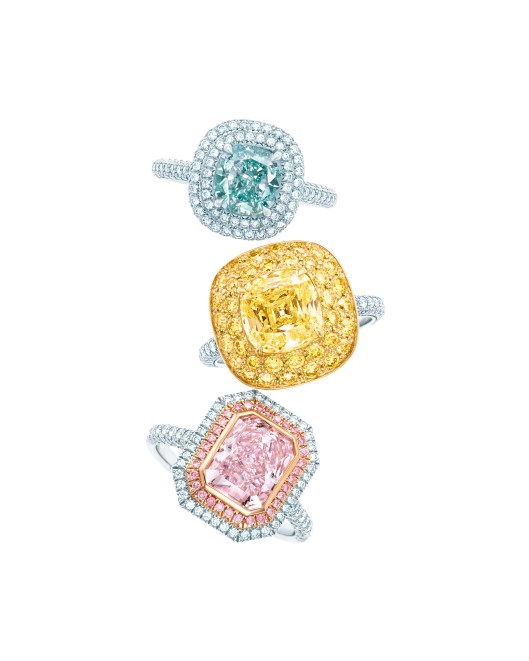 Tiffany diamond rings (from top): cushion-cut fancy intense bluish green diamond Ring in platinum , square antique modified brilliant cut fancy yellow diamond ring with melee diamond border in platinum and 18 karat yellow gold, cushion mixed-cut fancy intense purplish pink diamond ring with pink diamond in platinum and 18 karat rose gold.