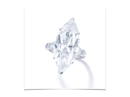 SUPERB DIAMOND RING, GRAFF The marquise-shaped diamond weighing 16.37 carats, set between tapered baguette diamond shoulders, size 59, signed Graff, together with an alternative ring mount, Graff.