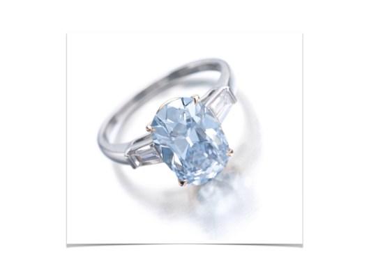 RARE FANCY INTENSE BLUE DIAMOND RING The cushion-shaped fancy intense blue diamond weighing 3.16 carats, set between tapered baguette diamonds.