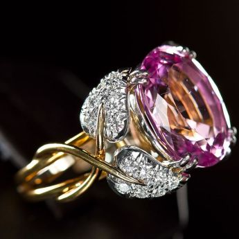 Tiffany & Co. Jean Schlumberger Pink Topaz Ring. This exquisite iconic Jean Schlumberger designed floral ring is set with a rare oval cut natural intense pink topaz that weighs approximately 10.50 carats, mounted in four petals of diamonds and platinum with 18k golden stems winding down to create the band. France, 20th century.