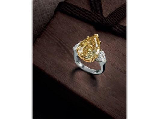A FANCY COLOURED DIAMOND AND DIAMOND RING