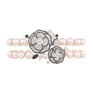 """Les Intemporels de Chanel. """"Camélia Gansé"""" bracelet in 18K white gold set with 3 marquise-cut diamonds, 248 brilliant-cut diamonds for a total weight of 3.1"""