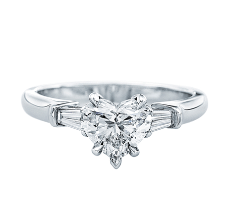 Classic Winston™, Heart-Shaped Diamond Engagement Ring. A heart-shaped diamond, 1.08 carats, set as a ring with tapered baguette side stones; total weight 1.31 carats; platinum setting.