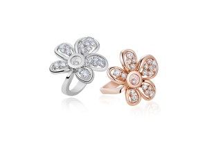 """Flower"" rings from the Happy Diamonds Joaillerie collection in 18ct rose or white gold with one moving diamond and set with brilliant cut diamonds of different sizes (1.4cts)"