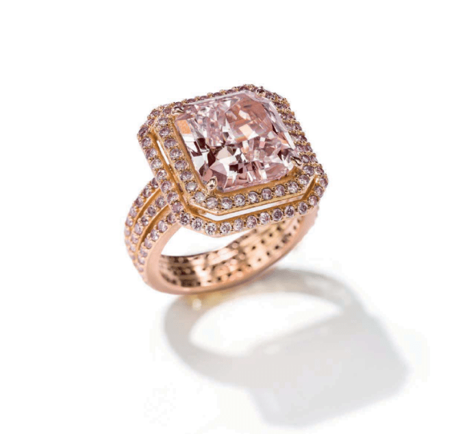Rectangular-cut Fancy Purplish Pink Internally Flawless Type IIa diamond ring.