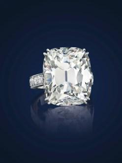 A CUSHION-CUT K-COLOR VS2 DIAMOND OF 25.82 CARATS ESTIMATE: $600,000 – $700,000