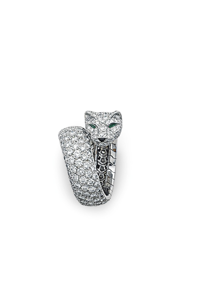 """A DIAMOND, EMERALD AND WHITE GOLD """"PANTHÈRE"""" RING, BY CARTIER ESTIMATE: $40,000 – $50,000"""