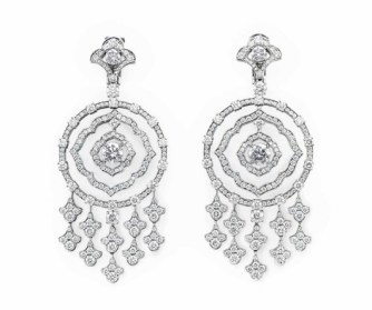 A PAIR OF DIAMOND EAR PENDANTS, BY GRAFF Each suspending articulated circular-cut diamond hoops, centering upon a circular-cut diamond, weighing approximately 1.02 and 1.01 carats, with a circular-cut diamond fringe, to the surmount of similar design, mounted in 18k white gold.