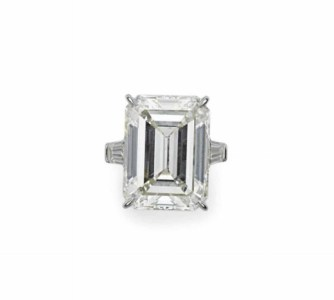 AN IMPRESSIVE DIAMOND RING Set with a rectangular-cut diamond, weighing approximately 22.31 carats, flanked on either side by a tapered baguette-cut diamond, mounted in platinum.
