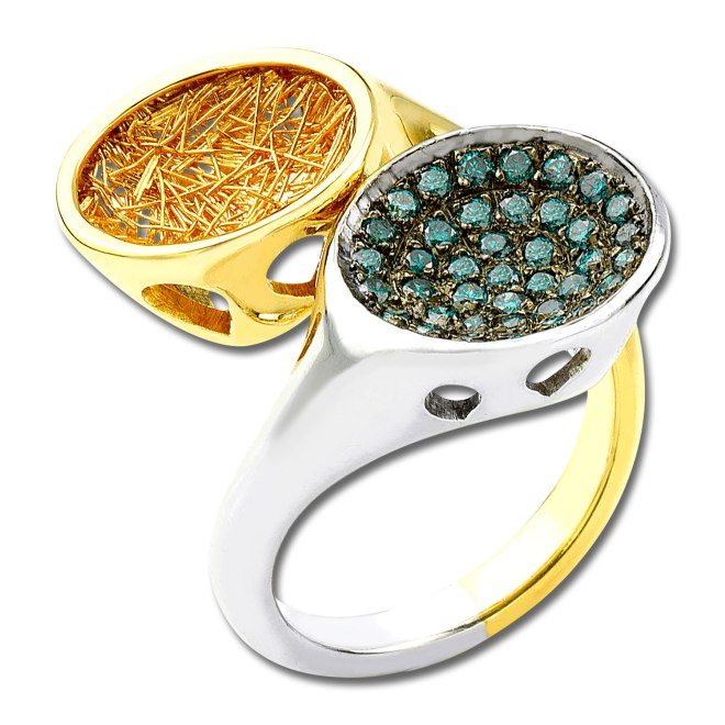 Sun in Moonlight ring - capturing the unique moment when the Sun  meets the Moon for some minutes of the day, as according to Greek mythology. Represented by the yellow of the sun with 18k yellow gold and the silver of the moon with 18k white gold which create a crate full of blue brilliant round-cut diamonds (0.59 acts).