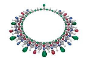 High Jewellery necklace in white gold with 7 drop shaped Zambian emeralds (120.93 ct), 24 round and drop shaped emerald beads (36.04 ct), 161 buff top emeralds (2.90 ct), 17 round and drop shaped sapphire beads (59.06 ct), 98 buff top sapphires (5.37 ct), 21 round and drop shaped ruby beads (83.73 ct), 126 buff top rubies (4.87 ct), 4 pear brilliant cut diamonds (4.01 ct), 18 pear brilliant cut diamonds (8.73 ct) and pavé diamonds (28.90 ct).